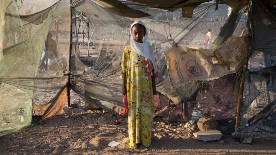 © UNICEF/UNI193467/Bindra - A girl stands at the main market in Dire Dawa, Ethiopia.