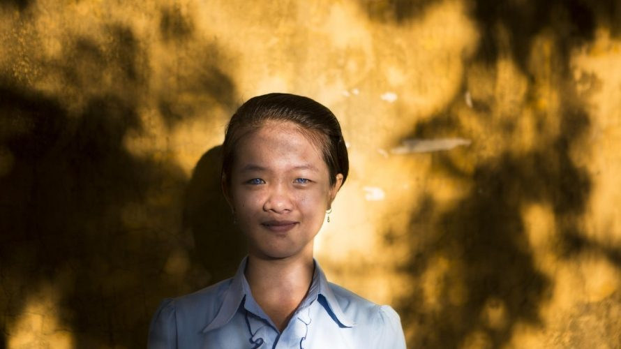 © UNICEF/UNI141958/Macksey - Nguyen Thi Anh, 14, who is deaf, stands outside Nguyen Dinh Chieu Special School, which she attends, in the city of Da Nang, Viet Nam. Violence is clearly linked to economic shocks in the family, such as death, illness or loss of a job. In Viet Nam children perceived economic hardship as the cause of increased tension and stress leading to more exposure to violence at home.