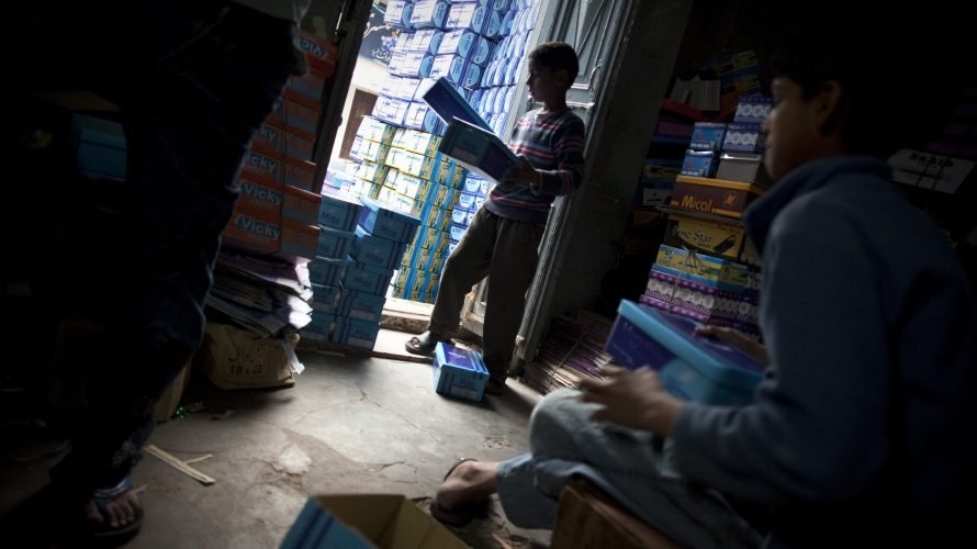 Child working in a shoe box factory in Pakistan