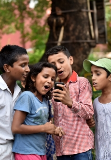 SOWC 2017 India children use mobile phone