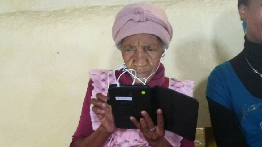 Grandmother completing questionnaire on a tablet