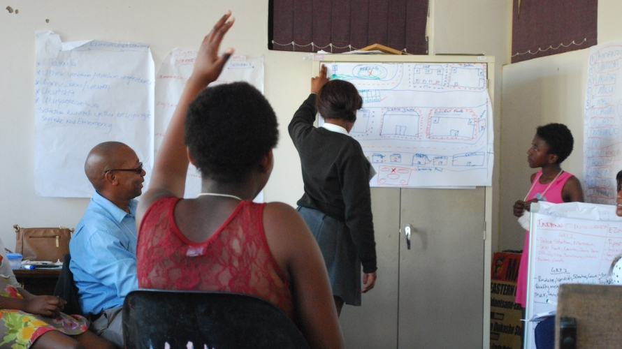 Adolescents mapping their neighbourhood in one of the Sinovuyo teen sessions