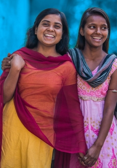 Two adolescent girls, India, Blue wash