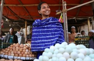 Aysha Akhter Khushi (18) received a stipend of 15,000 Taka under a conditional cash transfer project from UNICEF. With the money, she started her own business where she sells eggs. She earns around 500 to 600 Taka daily. © UNICEF/UN069642/Kiron