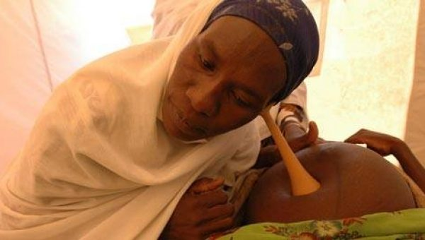 A woman health performs antenatal check up of a pregnant woman