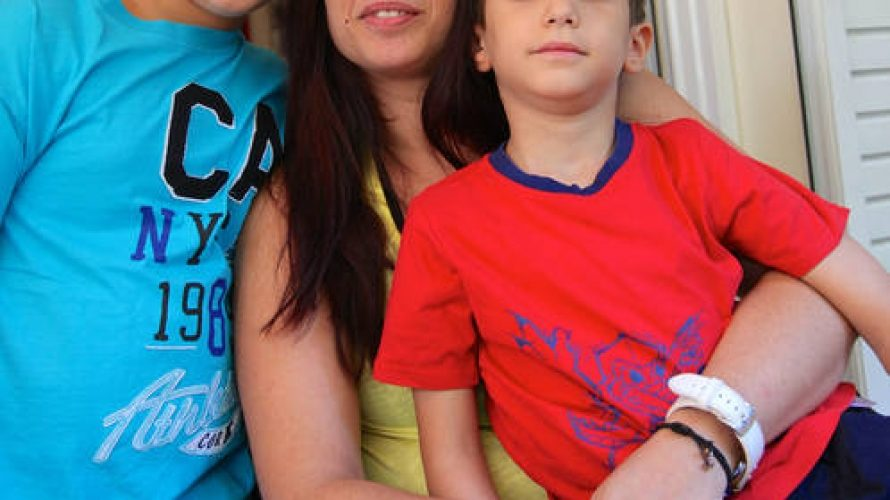 UNICEF /OoR-Innocenti/Giacomo Pirozzi/2014 - (Sept. 2014) Angeliki and her two boys Angelos (blue shirt) and Vasilis (red shirt) and their in their home in Athens, Greece. Angeliki is jobless and had to move into her mother's very small apartment with her boys. The four of them live on a pension of 400 Euros per month. Photographer: Giacomo Pirozzi