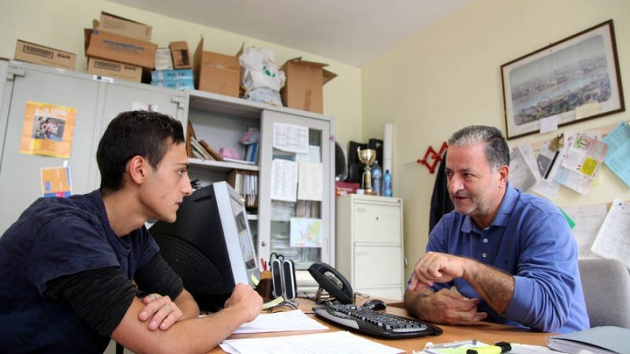 UNICEF/OoR-Innocenti/Giacomo Pirozzi/2014 - (Sept. 2014) Mirko De Fraia talking with a social worker in the labour office. Mirko, 17, lives in a poor suburb of Turin, Italy. He left school and he is looking for a job to help support the family. He hopes to attend a vocational training course in the future but would rather find a job. Photographer: Giacomo Pirozzi