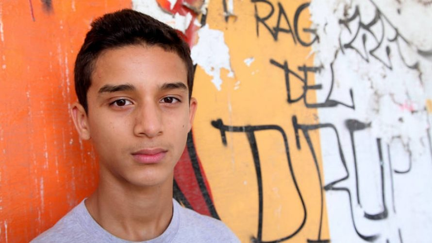 UNICEF/OoR-Innocenti/Giacomo Pirozzi/2014 - (Sept. 2014) Walid Mechrhale stands by a graffiti wall near Alkadia Youth Centre in Turin, Italy. Walid, 14, was born in Italy from Moroccan parents. He attends a technical school. Photographer: Giacomo Pirozzi