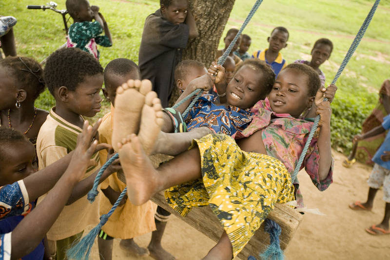 © UNICEF/NYHQ2007-0967/Olivier Asselin - Children play on a swing outside Kotonli Kindergarten in the village of Kotonli in Savelugu-Nanton District in Northern Region - Ghana