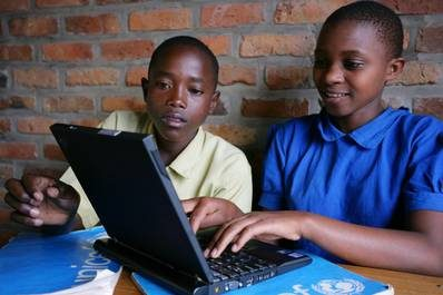 ©UNICEF/NYHQ2007-1397/Pirozzi - A girl and a boy use a laptop computer in the primary school in the village of Kawangile in Eastern Province, about 100 km from Kigali, the capital of Rwanda. UNICEF provides educational supplies and supports teacher-training at the child-friendly school, and also supported construction of the school and its sports and play areas and provided latrines.