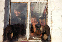 ©Capital's Eye, Moscow/2000 - Village Krutchevka, farmer's children are looking from the window, June 2000